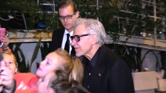 harvey keitel & daphna kastner at the chanel & charles finch pre oscar dinner in los angeles in celebrity sightings in los angeles, - ハーヴェイ カイテル点の映像素材/bロール