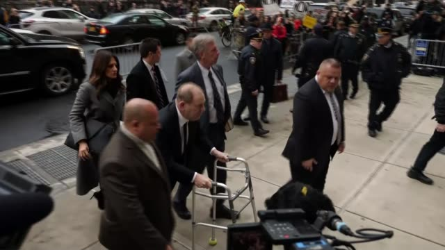 new charges announced by la prosecutors as trial opens in new york usa new york city manhattan ext various of harvey weinstein along from car to... - prosecutor stock videos & royalty-free footage