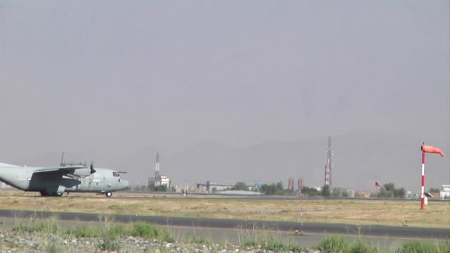 has been asked to deliver ballots from the 2014 afghan presidential run-off election to kabul. thisl was shot at north kabul international air port.... - bagram air base stock videos & royalty-free footage