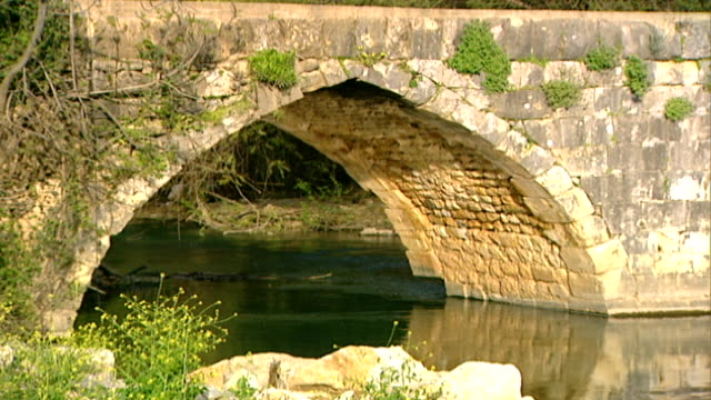hasbani river. mcu view of an ancient roman bridge spanning the river. the hasbani runs for 25 miles in lebanon before crossing into israel. - rapid stock videos & royalty-free footage