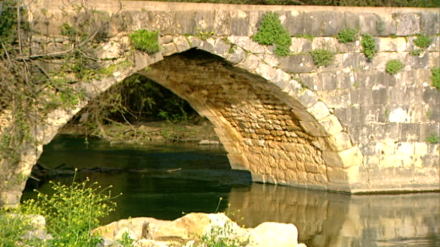 hasbani river. pan-right across an ancient roman bridge spanning the river. the hasbani runs for 25 miles in lebanon before crossing into israel. - rapid stock videos & royalty-free footage