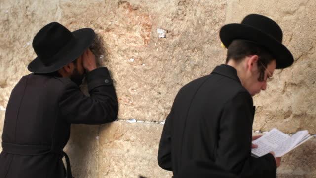 hasidic jews pray at the western wall. - wailing wall stock videos & royalty-free footage