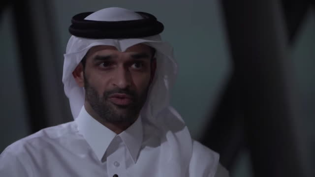hassan althawadi head of delivery qatar 2022 interview talks about pay for workers and minimum wage - employment issues stock videos & royalty-free footage