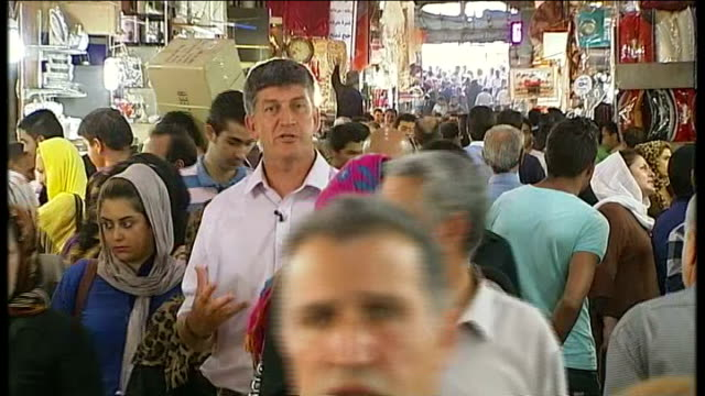 vidéos et rushes de hassan rouhani becomes new president of iran; professor sadegh zibakalam interview sot reporter to camera vox pops bank tejarat sign with people... - président