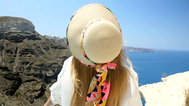 Hat falling down & beauty in Santorini