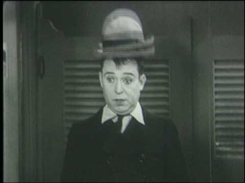 b/w 1933 hat jumping up + down on frightened man's head (harry langdon) - 1933 stock videos & royalty-free footage