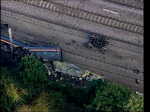 manslaughter charges lib england hertfordshire hatfield wreckage of train on tracks in aftermath of derailment broken section of track emergency... - hatfield stock videos and b-roll footage