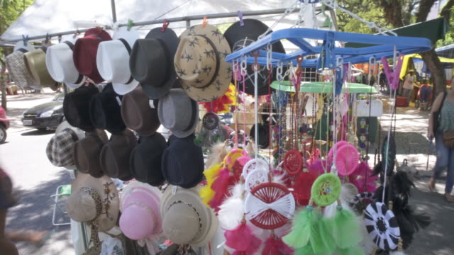 hats and dreamcatchers in the saturday market porto alegre, southern brazil - porto alegre stock-videos und b-roll-filmmaterial