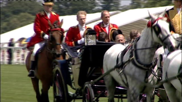 hats on display/ queen and royals arrive at ladies day; queen elizabeth ii arriving in horsedrawn carriage with prince philip, followed by carriages... - horsedrawn stock videos & royalty-free footage