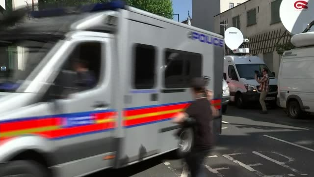 men appear in court / tenth man arrested by police convoy of police vehicles and prison vans arriving at court - convoy stock videos & royalty-free footage