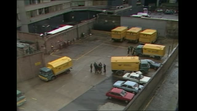 court told brian reader was previously jailed over 1983 brink's mat robbery as060483018 shoreditch ext high angle view of security express vans in... - mat stock videos and b-roll footage