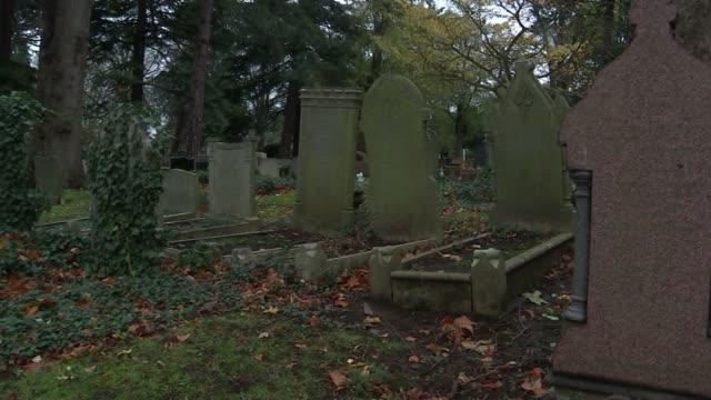 Jewels buried under memorial stones in cemetery London Edmonton Cemetery PAN gravestones in cemetery