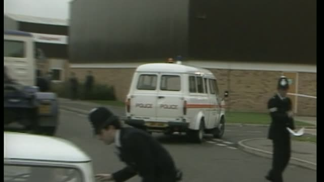 stockvideo's en b-roll-footage met three men found guilty 2911985 / as290185003 kent dartford brian reader from police van covered with blanket / november 1983 heathrow ext / day... - steel