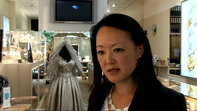 hatton garden jewellery week: world's most expensive wedding dress on display; england: london: hatton garden: wedding dress valued at 240,000 pounds... - platinum stock-videos und b-roll-filmmaterial