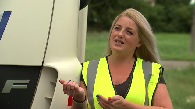 campaign to encourage more women to become hgv drivers; england: ext low angle view of lorries and cars along road tracking shot along road next to... - england stock videos & royalty-free footage