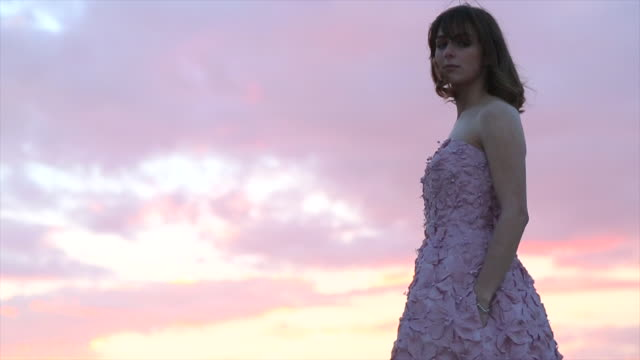 haute couture model poses against a desert backdrop, sunset - mid length hair stock videos & royalty-free footage