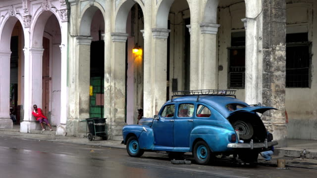 havana city, havana, cuba-april 8, 2015: left pan to an american car that is broken in el prado. old obsolete cars are an integral part of the cuban... - tarmac stock videos & royalty-free footage