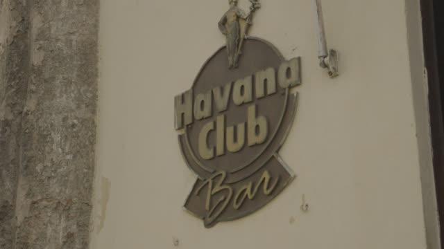 Havana Club buildings and signage in Havana Cuba on January 27th 2015 Shots Exterior wide shots of the front of the Havana Club Bar building Close...