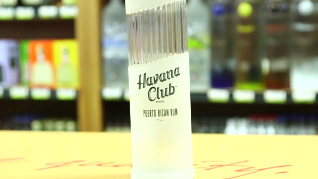 havana club rum bottles in a liquor store and bar in havana cuba on january 27th 2015 shots wide and close shots of havana club bottles on top of a... - rum stock videos and b-roll footage