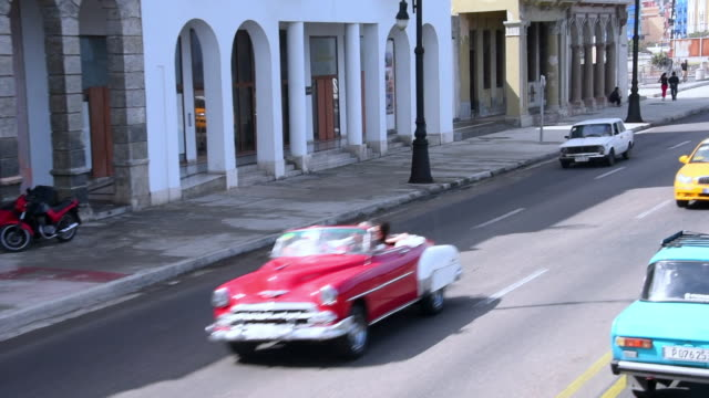 havana, cuba: aerial view of the malecon avenue with old cars amid the the traffic of the capital city - la havana video stock e b–roll