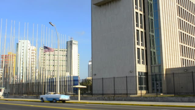 havana cuba an important photo of the usa flag flying at the usa embassy for the first time in 2016 for over 55 years - us embassy stock videos & royalty-free footage