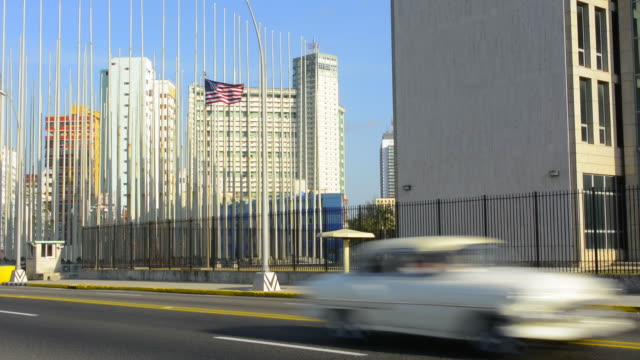 havana cuba an important photo of the usa flag flying at the usa embassy for the first time in 2016 for over 55 years - cuba stock videos and b-roll footage