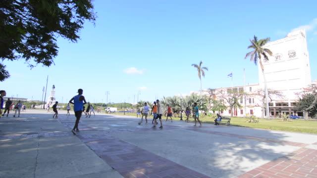 Havana Cuba boys playing soccer football in center of city Habana