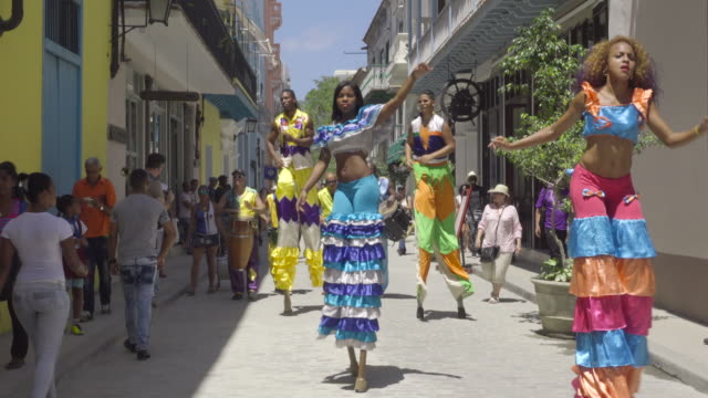havana cuba colorful dancing traditional show with stilt walkers on the street. old havana district landmark for tourists - stilts stock videos and b-roll footage