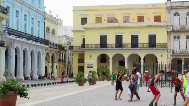 havana cuba: daily lifestyle in the old plaza or 'plaza vieja' - plaza vieja stock videos and b-roll footage