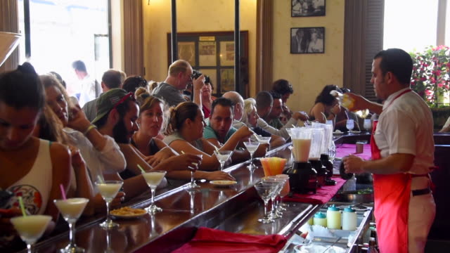 havana, cuba: 'el floridita', indoors at the famous tourist attraction in old havana - bar stock-videos und b-roll-filmmaterial
