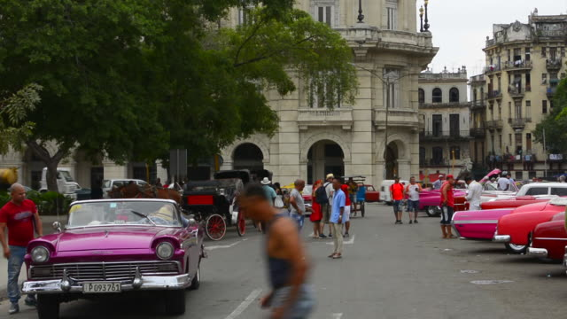 Havana Cuba Habana central colorful old classic 1950's car on display near Capital for rental by tourists Cuba today