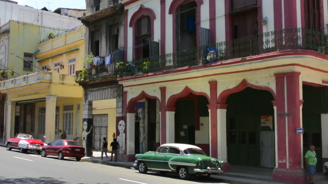 Havana Cuba Habana central colorful old classic 1950's cars on display near Capital for rental by tourists Cuba today