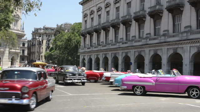 stockvideo's en b-roll-footage met havana cuba habana central colorful old classic 1950's cars on display near capital for rental by tourists cuba today - cuba