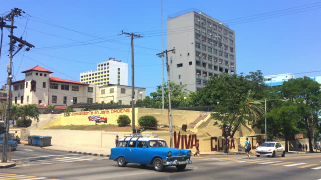 Havana Cuba: Old vintage cars in 'El Vedado' or downtown district during the daytime