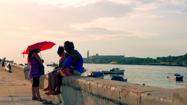 havana, cuba, people in el malecon during the day - high contrast stock videos & royalty-free footage