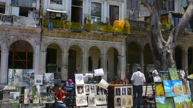havana cuba prado city walk in center with art for sale and locals walking - drawing art product stock videos & royalty-free footage