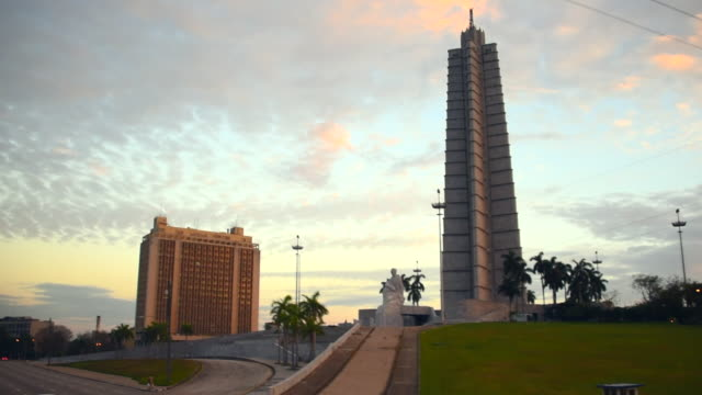 Havana, Cuba: Revolution Square at dusk hour, aerial point of view from a turning double decker tour bus