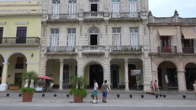 havana cuba: tilt up of colonial architecture buildings in the old plaza or plaza vieja - plaza vieja stock videos and b-roll footage
