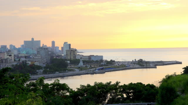 Havana, Cuba: urban skyline in golden sunset, aerial view point of view from 'El Morro' castle