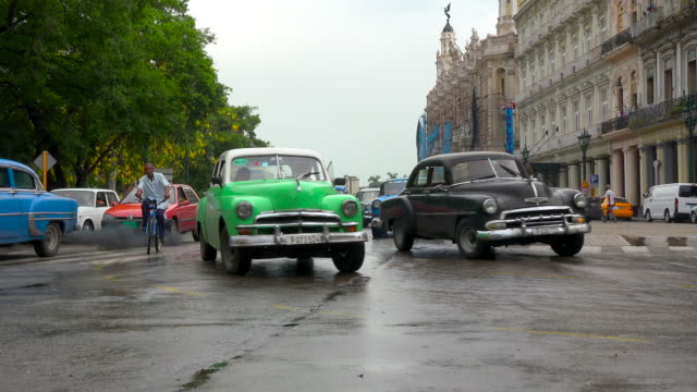 havana, cuba: variety of old obsolete american cars making a turn at 'el prado' in the cuban capital city - cuba stock videos & royalty-free footage