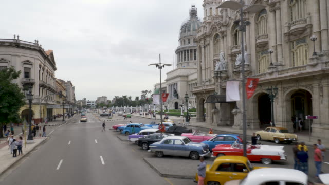 havana parque central, traveling shot with vintage cars - socialism stock videos & royalty-free footage