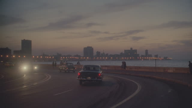 d/x (twilight) havana skyline with 1950's traffic in f.g.; takes progressively darker - latin america stock videos & royalty-free footage