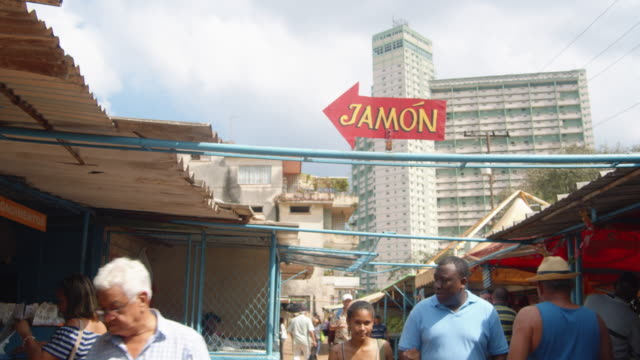 havana street market. jamon ham banner with focsa building on the background - cuban culture stock videos & royalty-free footage