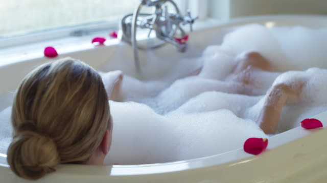 have a soak with bubbles - bubble bath stock videos & royalty-free footage