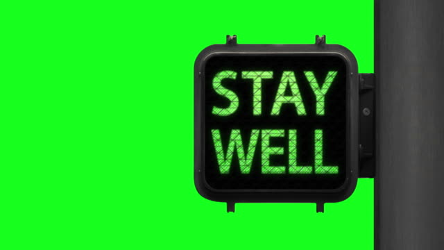have hope. stay well—chroma key shot of green walk signal with hopeful phrase with green screen in the background - green light stock videos & royalty-free footage