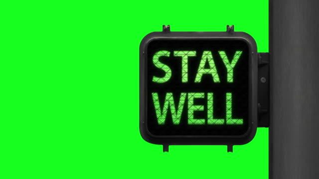 vídeos y material grabado en eventos de stock de ten a hope. stay well—chroma key shot of green walk signal with hopeful phrase with green screen in the background - luz verde semáforo