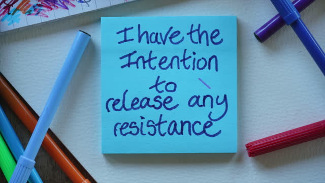 """""""i have the intention to release any resistance"""" affirmation notes - sticky stock videos & royalty-free footage"""