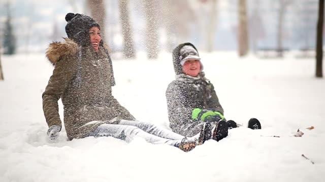 having a break in snowy field - sliding stock videos & royalty-free footage