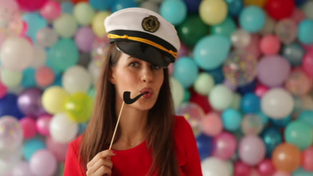 having a lot of fun with party props - sailor hat stock videos & royalty-free footage