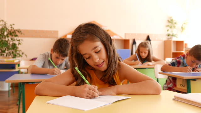 having an exam in classroom - primary school child stock videos & royalty-free footage
